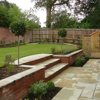 How to cope with a sloping garden alda landscapes for Garden design ideas new build