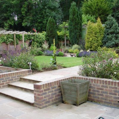 How to cope with a sloping garden alda landscapes the challenge sloping gardens workwithnaturefo